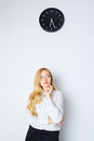 Office girl looking on clock watch and waiting end of work day Stock Photography