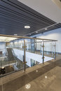 Office hall long of a modern with glass banister Royalty Free Stock Image
