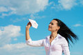 Office lady with a paper plane portrait of an in her hand blue sky background out of concept Stock Photos