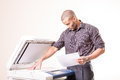 Office man making copies of documents african Stock Photos