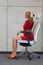 Office occupational disease prevention business woman exercising on chair Stock Image