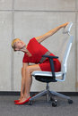 Office occupational disease prevention business woman exercising on chair Royalty Free Stock Photo