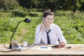 Office in park makes a smile on businesswoman face Royalty Free Stock Photo