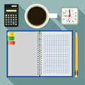 Office supplies and checked notebook Royalty Free Stock Photo