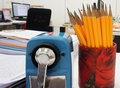 Office supplies on desk have document clip board document pensil sharpener etc Stock Photography