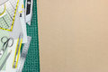 Office supplies, green cutting mat on brown recycled paper backg Royalty Free Stock Photo