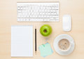 Office table with notepad, computer and coffee cup Royalty Free Stock Photo