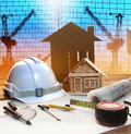 Office tower and home construction plan on architect working tab table with modern building crane background use for civil Royalty Free Stock Image