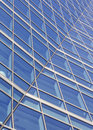 Office windows abstract an building of an building with interesting curves and bends Royalty Free Stock Photos