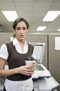 Office worker with coffee Royalty Free Stock Photo