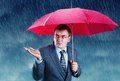 Office worker hiding under an umbrella from rain Royalty Free Stock Photos