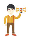 Office worker and his smartphone Royalty Free Stock Photo
