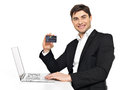 Office worker with  laptop and credit card Stock Photos
