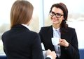 Office workers on coffee break, woman enjoying chatting Royalty Free Stock Photo