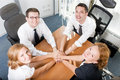 Office workers hold hands together Royalty Free Stock Images