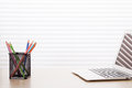 Office workplace with laptop and pencils Royalty Free Stock Photo
