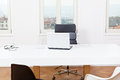 Office workplace table and laptop white background architecture nobody Stock Image
