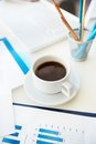 Office workplace vertical image of an with papers stationary and a cup of coffee Royalty Free Stock Photo