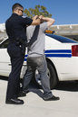 Officer Arresting Young Man Royalty Free Stock Photo