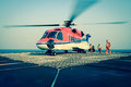 The officer take care passenger to embark helicopter at oil rig platform Royalty Free Stock Images