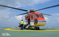 The officer take care passenger to embark helicopter at oil rig platform Royalty Free Stock Image