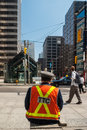 Officer of toronto transit commission observing traffic in downtown at university avenue and king street west ttc is public Royalty Free Stock Image