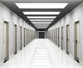 Offices a corridor with office doors entrances and a lift in the end Royalty Free Stock Photo