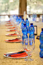 Official banquet table with empty dishes and glasses at beginning Royalty Free Stock Photos