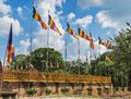Official flags of the Buddhism flutter on wind Royalty Free Stock Photo