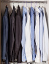 Official strict male clothes in a built in closet Stock Photos