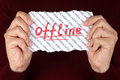 Offline piece of paper with red word on background with words online in the woman s hands Royalty Free Stock Photography