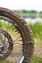 Offroad bike wheel detail view of the enduro dirt advneture with mud on it Stock Images