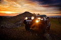 Offroad car on mountain road at sunset Royalty Free Stock Photo