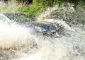 Offroad car splashing water Stock Image