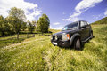 Offroad driving black land rover discovery taken out for picture taken in a green landscape during spring Royalty Free Stock Image