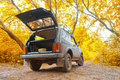 Offroad vehicle in autumn forest Royalty Free Stock Images