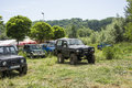 Offroad vehicle car x all wheel drive covered in mud outdoor big picnic charity poland city przemysl Stock Image