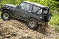 Offroad vehicle car x all wheel drive covered in mud outdoor big picnic charity poland city przemysl Stock Photos
