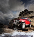 Offroad vehicle on the mountain terrain Royalty Free Stock Photo