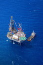 The offshore drilling oil rig top view from aircraft and supply boat Stock Photo