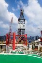 Offshore jack up drilling rig in the middle of the ocean aerial view Stock Image