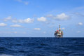 Offshore Jack Up Drilling Rig in The Middle of The Sea Royalty Free Stock Photo