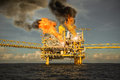Offshore oil and gas fire case or emergency case, firefighter operation to control fire on oil and gas production platform Royalty Free Stock Photo