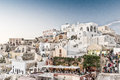 Oia greece may tourists await the famous sunset in santorini island a a summer tourist destination Royalty Free Stock Photo