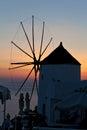 Oia mill at sunset santorini island greece Stock Photos