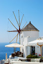 Oia old windmill in village santorini island greece Stock Photo