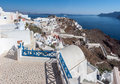 Oia santorini village with its typical white houses at the top of a steep hill greek island of thira Royalty Free Stock Image