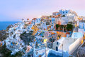 Oia at sunset santorini greece panoramic famous view old town of or ia on the island white houses and windmills dawn Stock Image