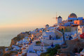 Oia sunset in village on santorini island greece Royalty Free Stock Photo