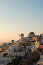 Oia sunset in village on santorini island greece Stock Photos